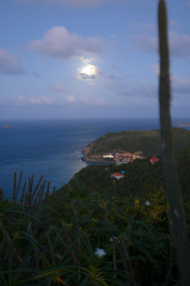 This is a handheld shot of the moon over Taiwanna, whose red roof and lights are visible below the moon. These moon shots were taken from our bedroom patio at Ker Roch Glaz.