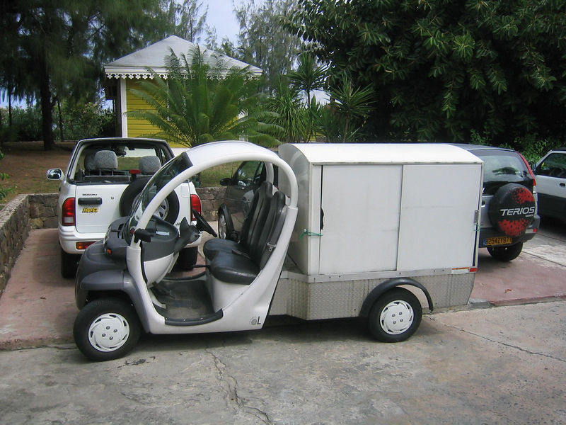A Smart Car as a covered truck.