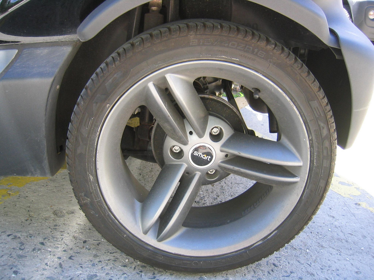 The smartly stylish wheel of a  Smart Car.