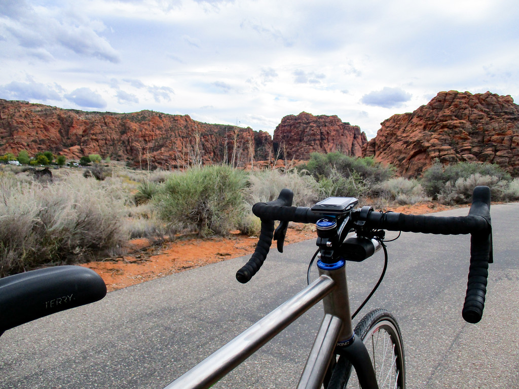 The bike, the snow path, and the canyon walls in Snow Canyon.