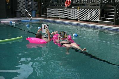 Shane & Aunika reading in the pool.