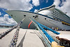 Royal Caribbean's  Adventure of the Seas tied down with a few strings at in the St. John's, Antigua port.