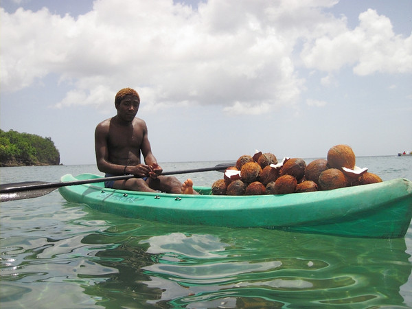 A coconut salesman at Anse Cochon.