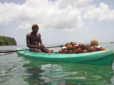 A coconut salesman at Anse Cochon.