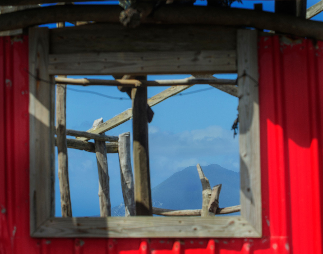 Old run down house currently being used as a chicken coop, Sandy Point Town, View of St Eustatus Island