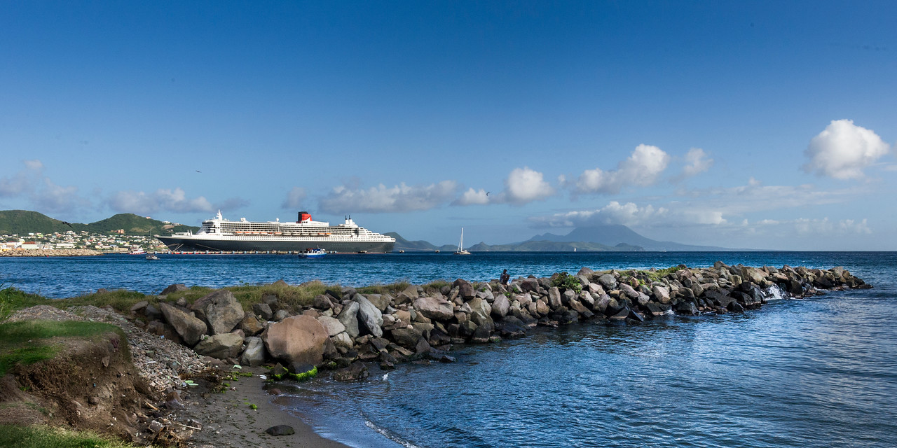Basseterre harbor with Nevis Island in the background, Queen Mary II making an infrequent call to port
