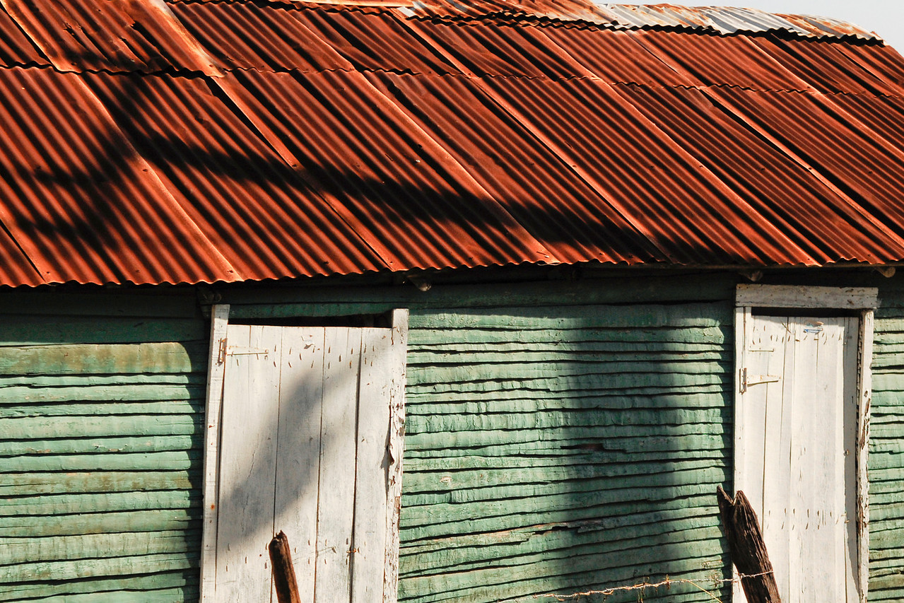 Roadside house, only the poor build with wood, on the road to Paraiso from Barahona, Dominican Republic