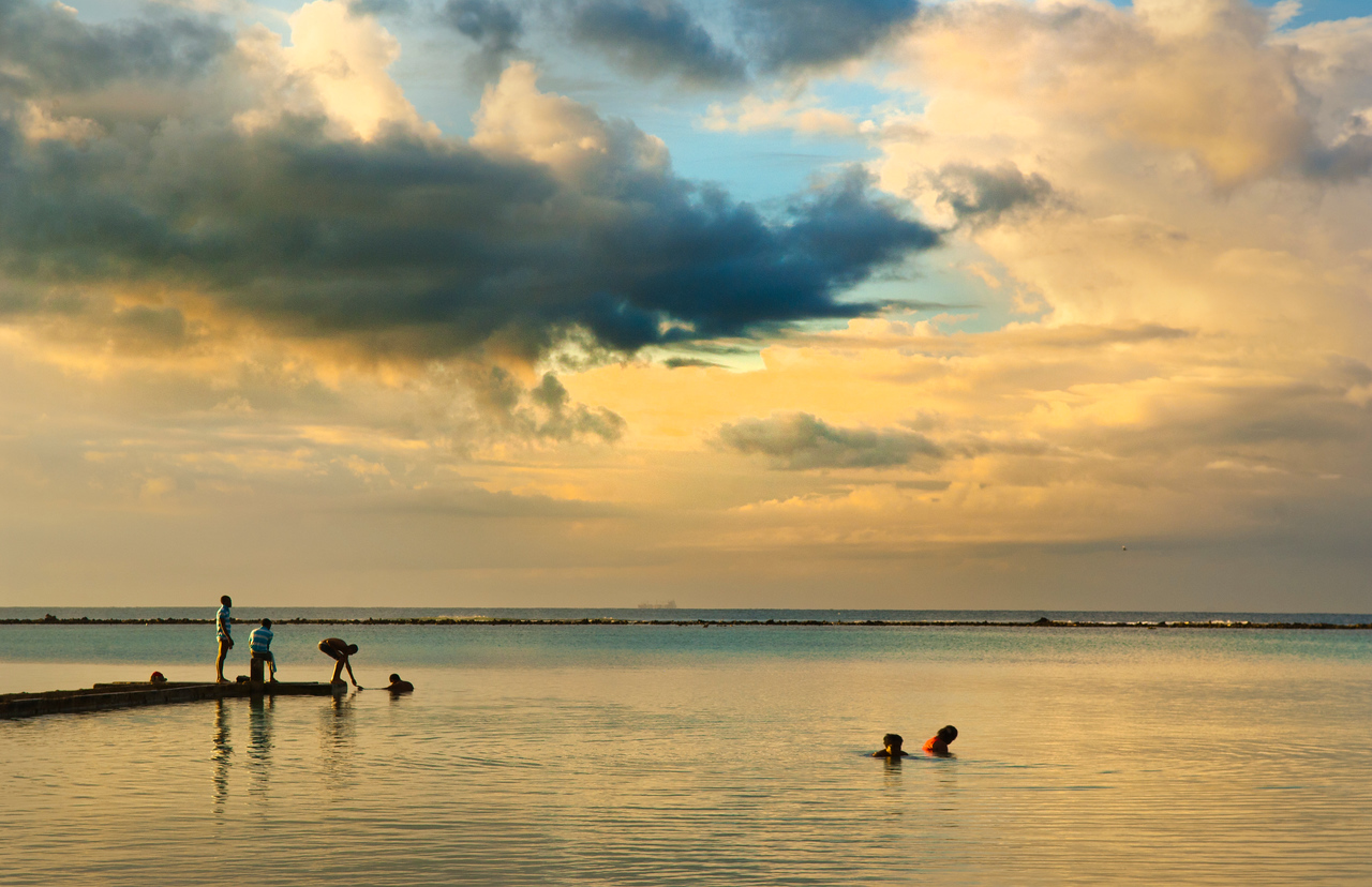 Boca Chica, Dominican Republic - The quality of the early morning light is wonderful; slow mornings awake with color as vendors hunt for shells.