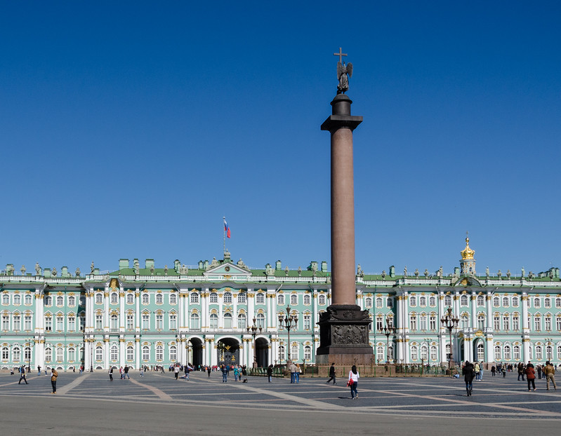 Winter Palace with Small Hermitage on right, and Alexander Column in Palace Square.<br>The Column is the world's largest free standing monument and is balanced by its 600 tonne weight.