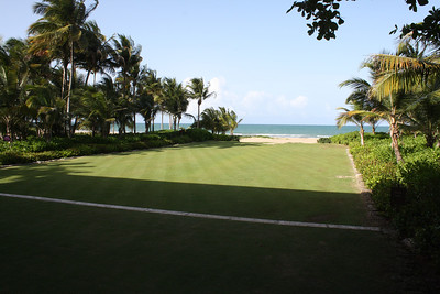 Beautiful grass outside of lobby leads to the beach