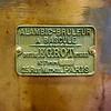 Perfume tank plaque