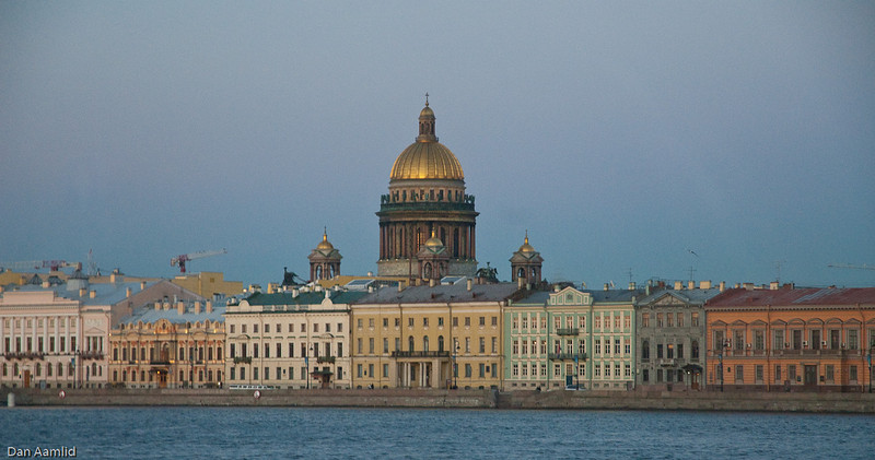 Night view of the Saint Isaac's Cathedral and English Quay  along the Neva River in Central Saint Petersburg