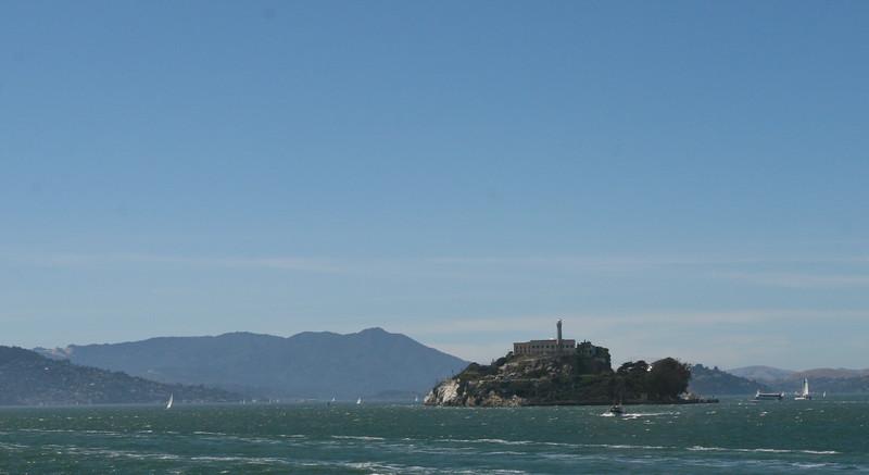 Boats sailing around Alcatraz Island.