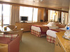 "The large ""S"" Suite with plenty of space and lots of windows and storage space. There are now flat panel TV's and DVD players in every cabin"