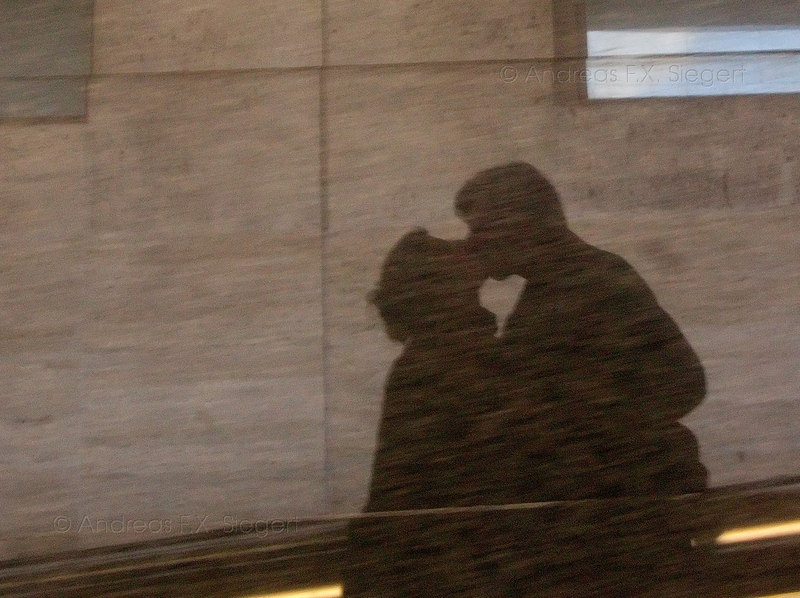 Kissing at Termini - a reflection in marble