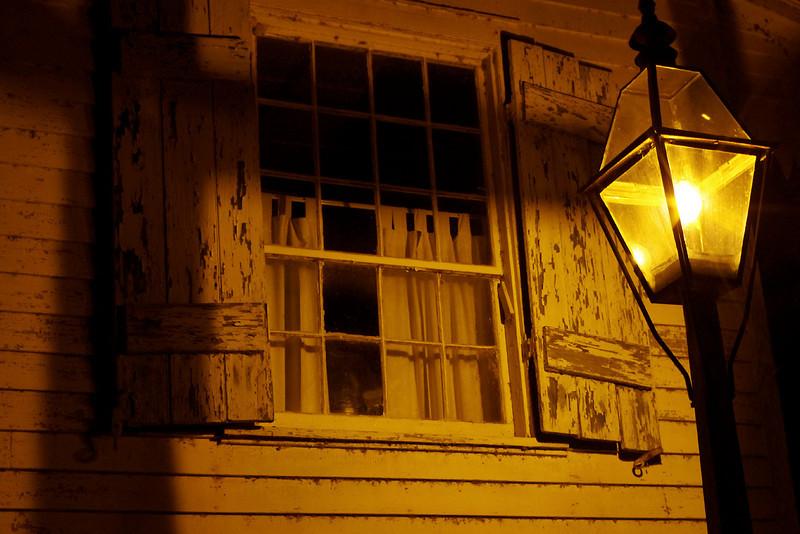 Street lamp and window shutters. Saint Genevieve, Missouri.