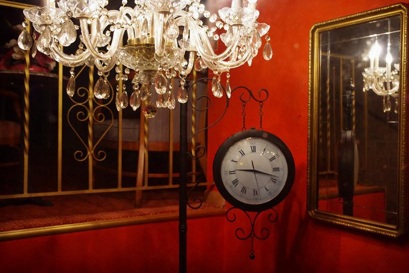 Shop window with clock and chandelier. Saint Genevieve, Missouri.