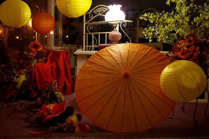 Paper lanterns and parasol in shjop window. Saint Genevieve, Missouri.
