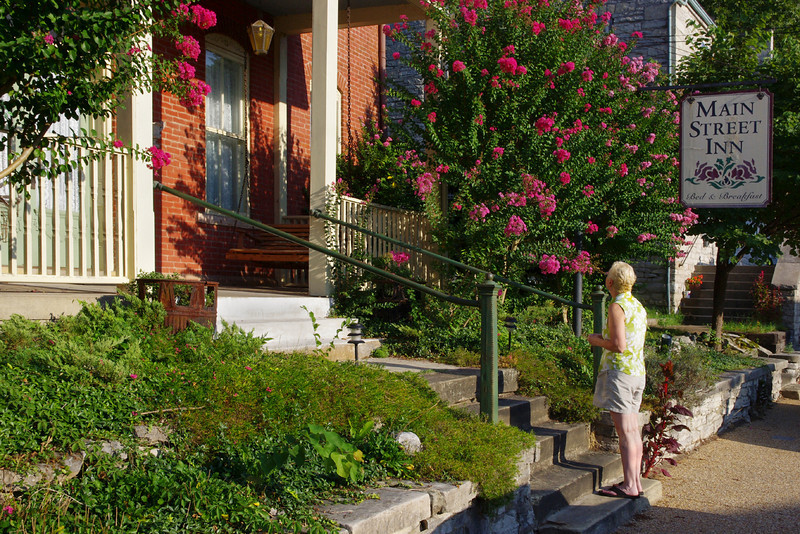 Rita in front of the Main Street Inn Bed and Breakfast, Saint Genevieve, Missouri.