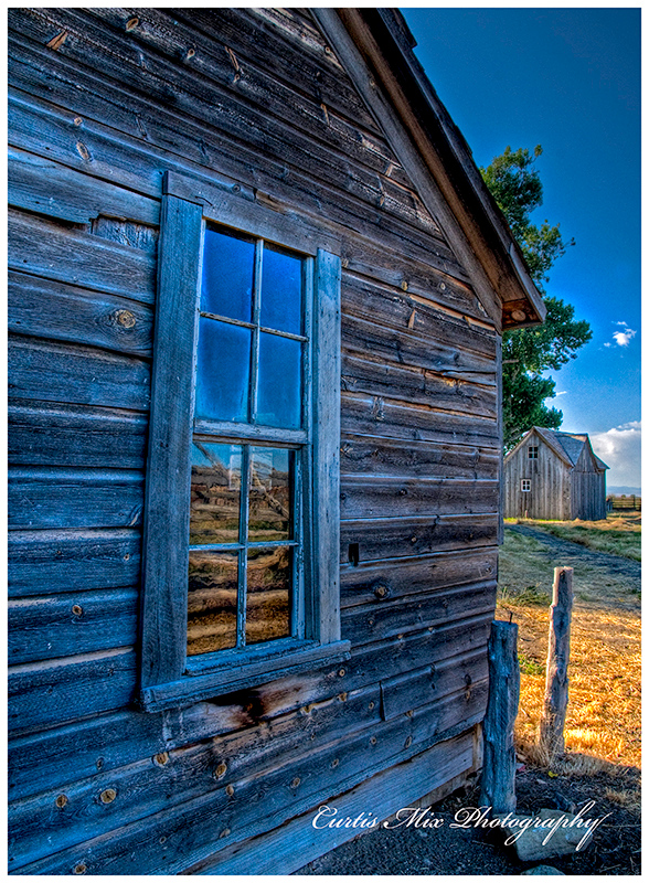 Old rippled glass window at sod house ranch.