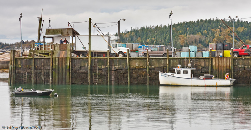 IMAGE 5: This was another view off of the deck. This is one of several places  where the lobster boats would bring their daily catches.  The refrigerated truck is where the lobster would be stored until later in the evening when a semi would pull in and take the lobster.