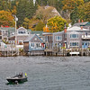 IMAGE 10: I got this shot standing on the weighing platform with Mike and Jim.  The Inn where we stayed is the one with the blue doors on the right..  Stonington is not a tourist town.  It is a true lobster village.