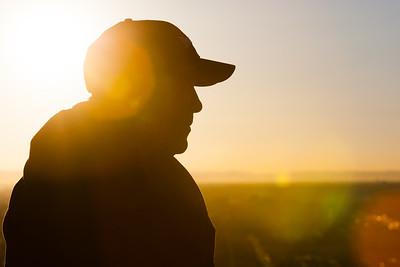 Capped Man at Sunrise