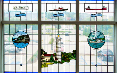 Maritime-themed stained glass window in the Museum