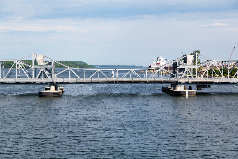 A railroad draw bridge parallels the Oregon Street Bridge.