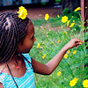 Hannah, Sabet and Suzy's daughter, picking flowers at the compound.
