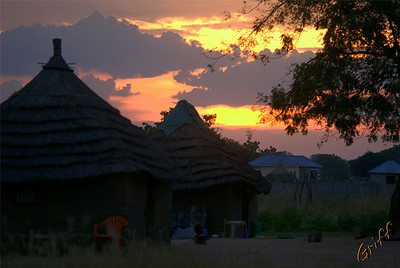 Sunset by some Sudanese huts.