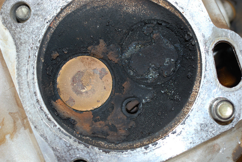 NASTY generator head and valves.  The carbon was an eighth inch thick.  The oil ring was full of sludge and stuck in the piston allowing oil to pass by.