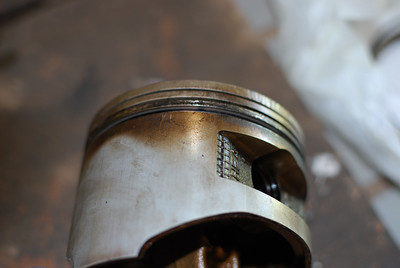 Dirty generator piston.  You can see the combustion leakage through the rings.