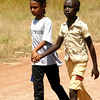 Hannah and her friend walking at the airstrip.