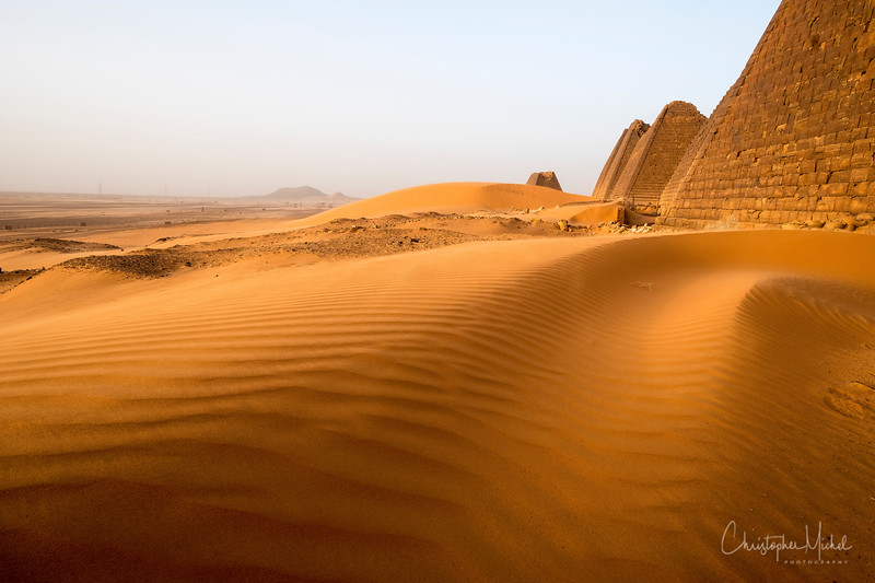 Sand dunes threaten to cover the pyramids.