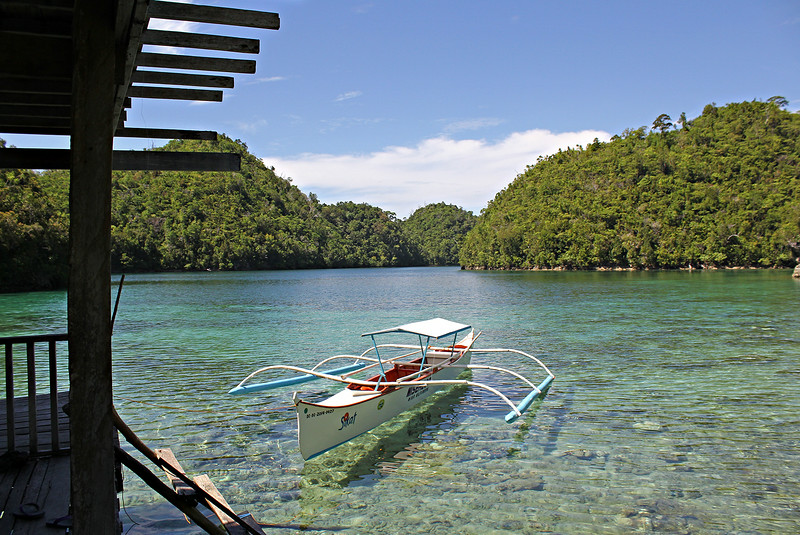 The tranquil clear waters gives that impression of the boat hovering on top of the water.   (Erwin M. Mascarinas)