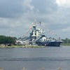 The USS North Carolina, moored across the Cape Fear River from Wilmington's Riverwalk. All flags flying for the Fourth.