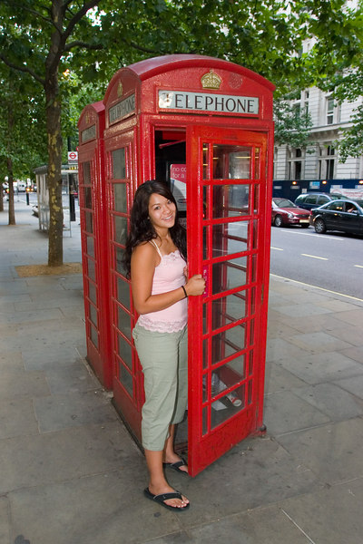 Gen in a London phone booth.
