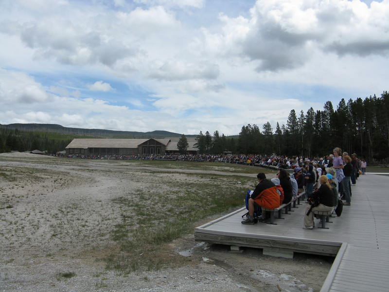 Crowds starting to form again for the next eruption of Old Faithful.