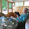 Ingrid sitting in our screened in porch.