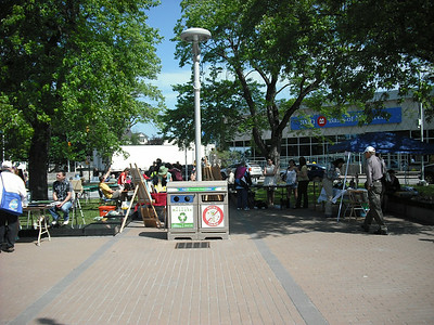 Center of town--street fair with various booths