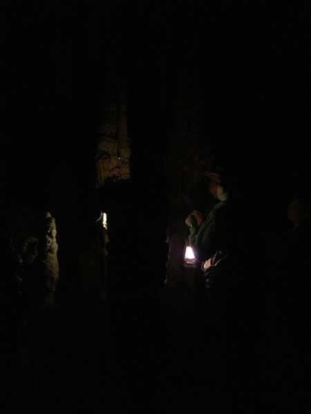 They had lanterns that simulated the old candle light, then turned off the lights. Very dark and dim.