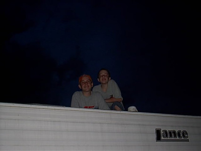 Fourth of July <br /> Grandsons Devon and Chris watching fire works from top of the camper.