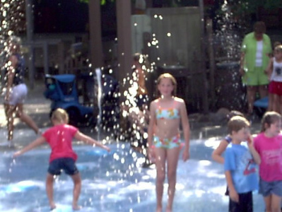 Dollywood <br /> Ashely having fun in the water.They have a kids area,water cannons,squirt guns..etc.