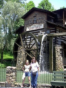 Mill <br /> In front of the water wheel. The mill still grinds corn/wheat.