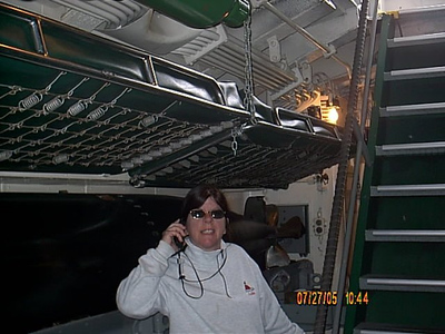 At the bottom of the stairs,note the bunk above my wifes head.Beds seemed to be put anywhere they could fit them.