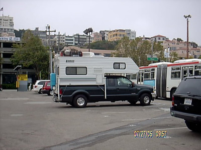 San Francisco <br /> 7/27/05-We drove to S.F. from Santa Cruz in the morning.We found a open parking area on Embarcadero across from pier 39. It was 15 dollars til 5:00am the next day. What you can't see in the pic is a street person asleep two spaces over. I wonder if he paid for parking?<br /> 7/19/2012   I just found out that this open parking lot is now a 5 level parking structure.