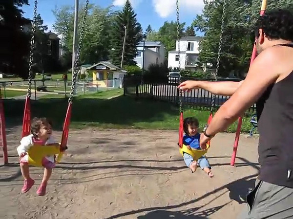 Cyane and Jaden on the swings in a little park in Ste-Agathe