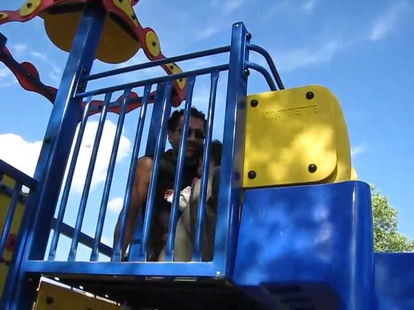 Weee!!! Daddy takes Cyane down the slide!
