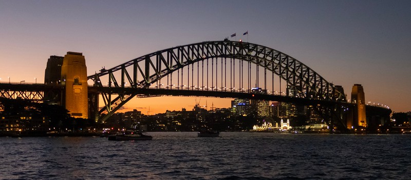 Sunset behind the Sydney Harbor Bridge.  If you look closely you can see groups of people climbing up the bridge.  I thought about doing this myself, but it was that or make a car payment - I chose a car payment (it's a tad pricy!)